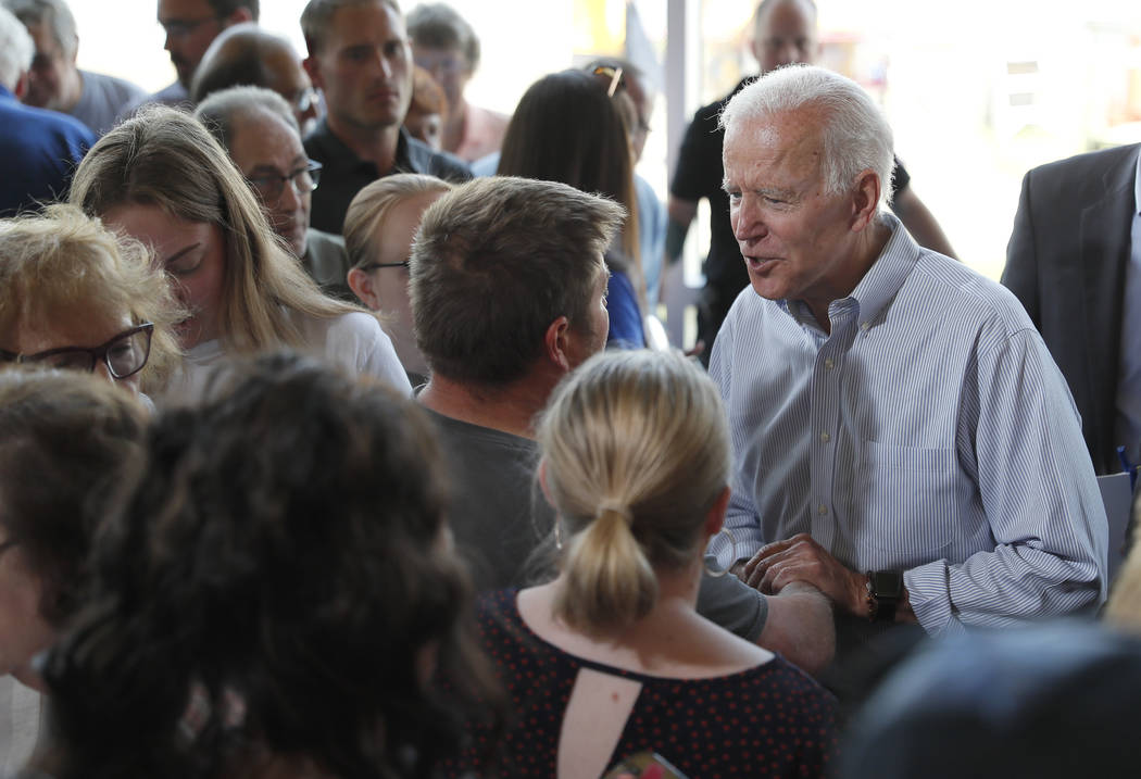 Democratic presidential candidate former Vice President Joe Biden greets supporters after a tow ...