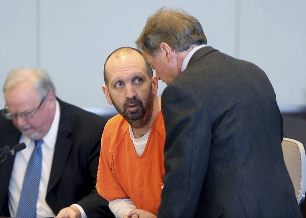 FILE - In a March 14, 2017 file photo, Craig Hicks, center, charged with the murder of three Mu ...