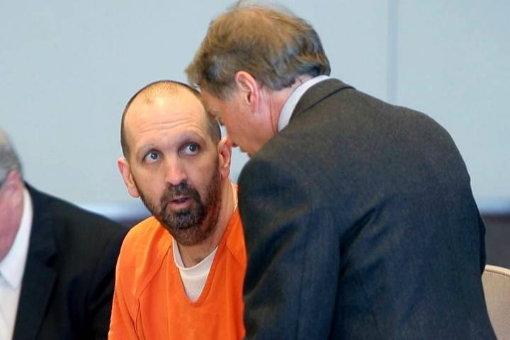 In a March 14, 2017, file photo, Craig Hicks, center, charged with the murder of three Muslim s ...