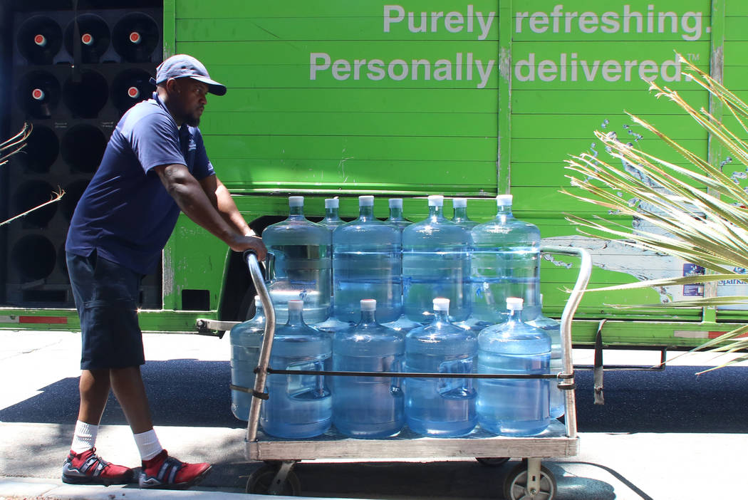 Sparkletts Water employee Ronnie Charles delivers Sparkletts water to Green Valley Ranch Resort ...