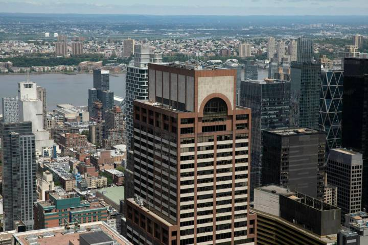 Law enforcement personnel work on the roof of the AXA Equitable building, center, Tuesday, June ...