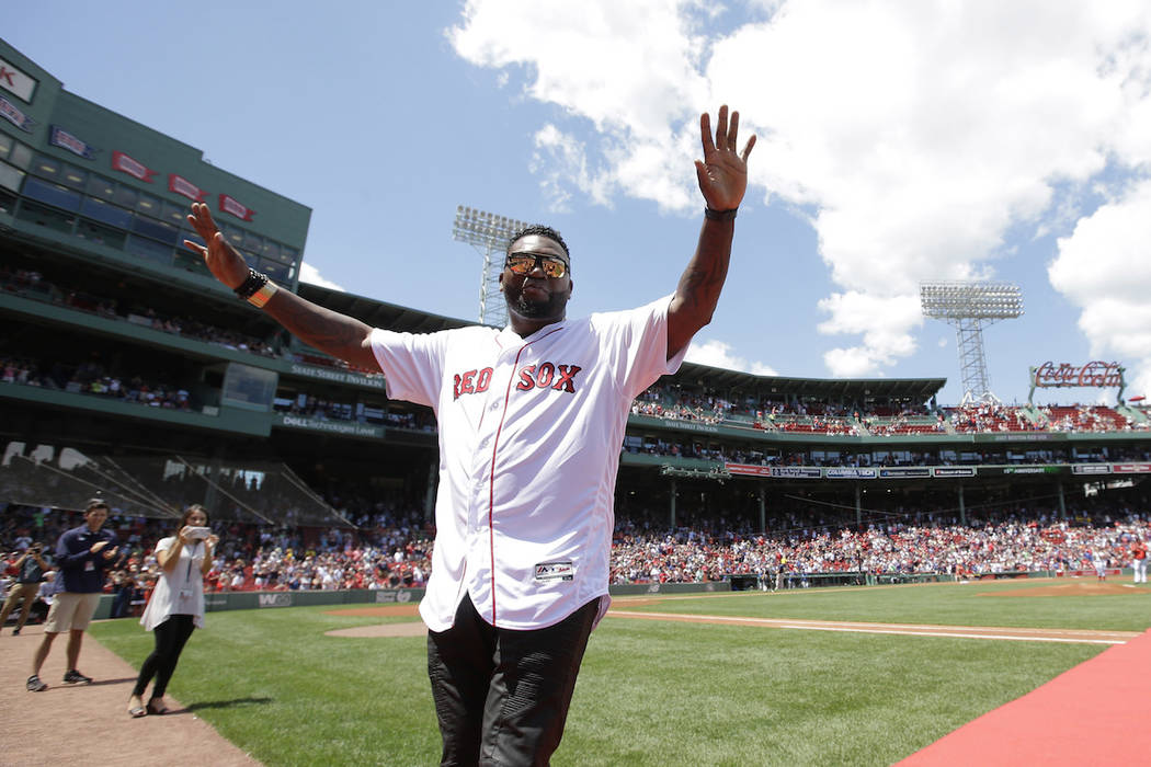 Former Boston Red Sox's David Ortiz waves to the crowd during ceremonies to honor the Red Sox 2 ...