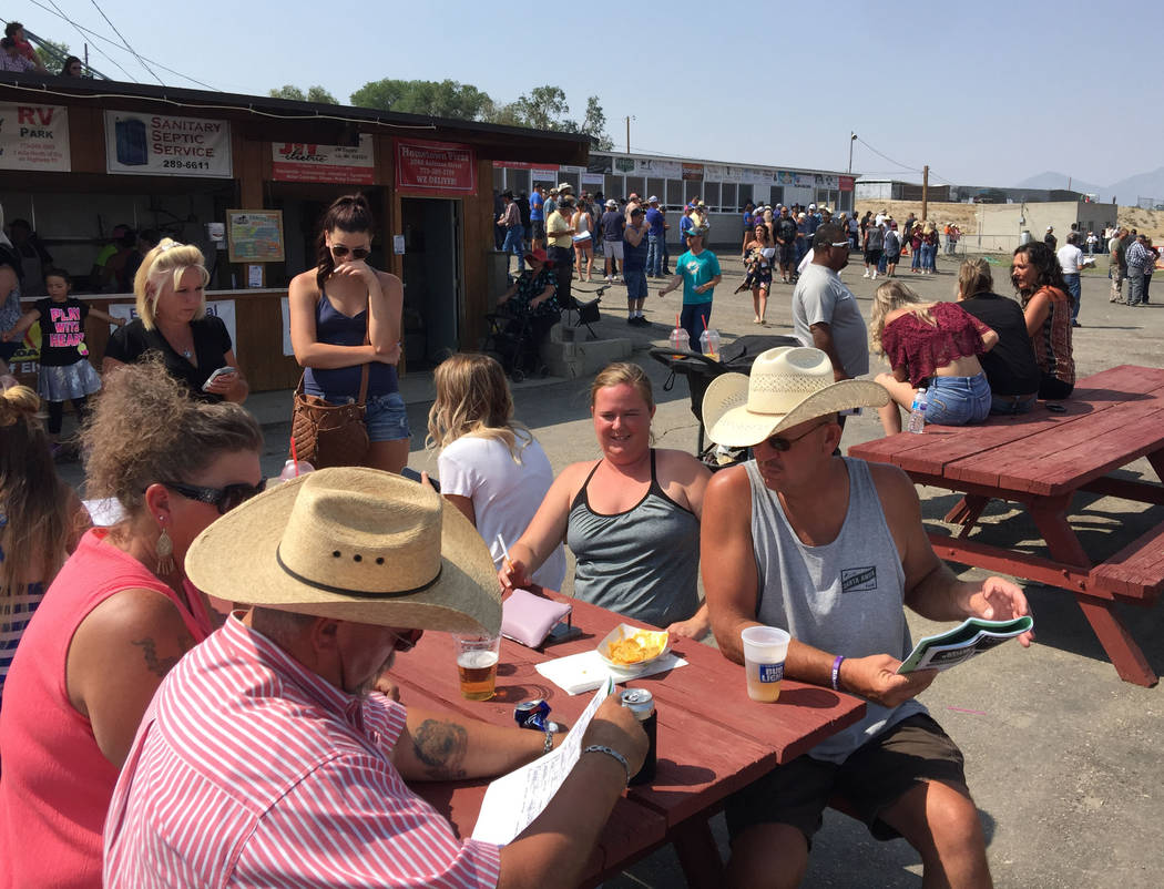 Fans handicap the next race at the White Pine Races on Sunday, August 19, 2018 in Ely. (Mike Br ...