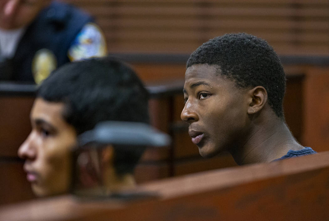 Defendants Josue Turcios and Tahj Simeus wait before the judge while appearing in Henderson Jus ...