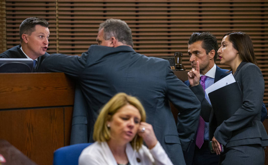 Judge Sam Bateman speaks to lawyers Keith Brower, Abel Yanez and Monica Trujillo who represent ...