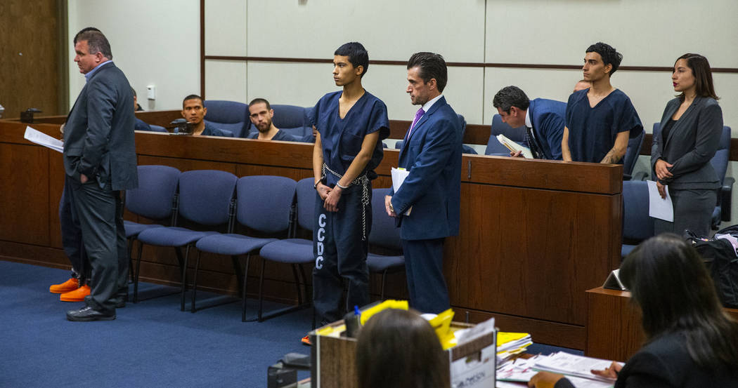 Defendants Tahj Simeus, Josue Turcios and Joseph DeFrancisco stand before the judge with their ...