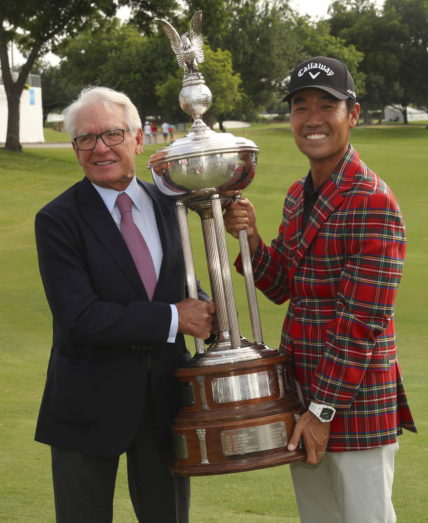Charles Schwab and Kevin Na pose with the Leonard Trophy after Na won the Charles Schwab Challe ...