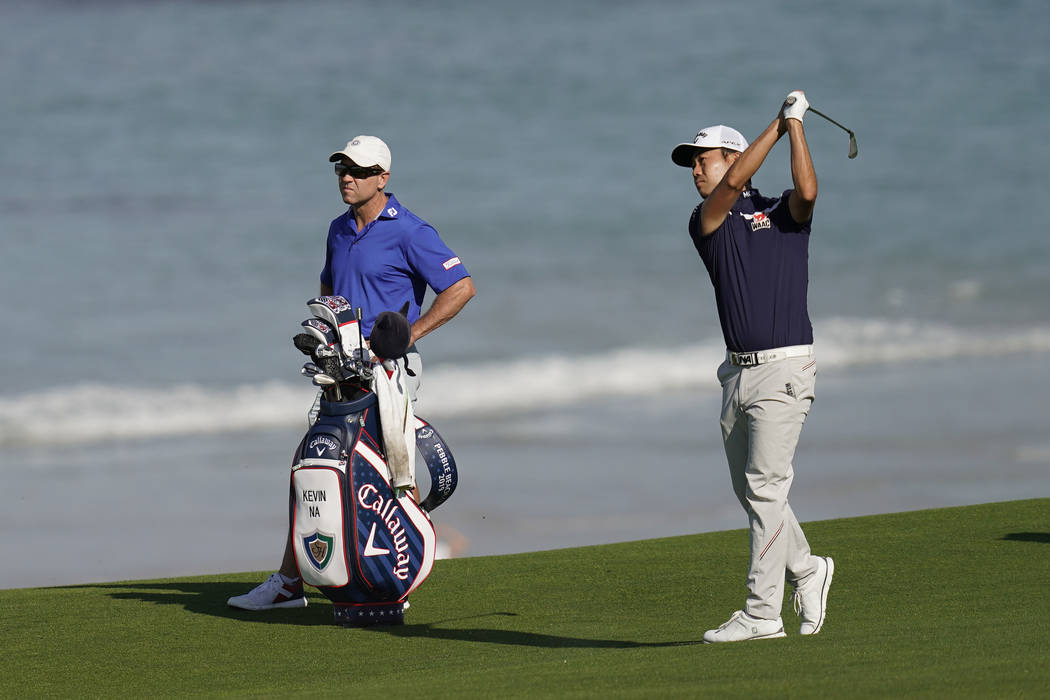 Kevin Na hits from the fairway on the 10th hole during a practice round for the U.S. Open Champ ...