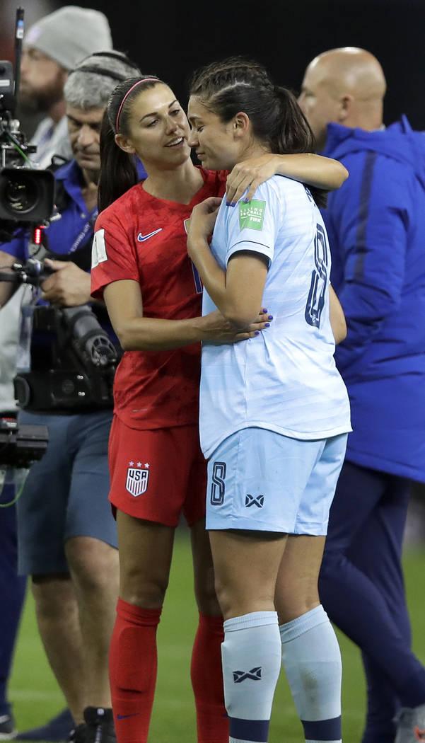 United States' Alex Morgan, left, comforts Thailand's Miranda Nild, right, after the Women's Wo ...
