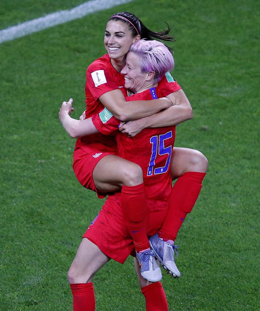 United States' Megan Rapinoe, right, congratulates teammate Alex Morgan after scoring her fifth ...