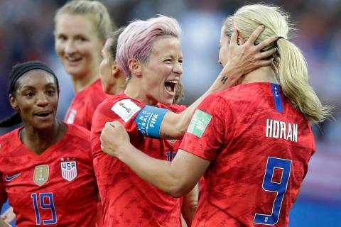 United States' scorer Lindsey Horan, right, celebrates their side's 3rd goal with Megan Rapinoe ...