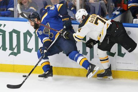 Boston Bruins left wing Jake DeBrusk (74) tries to stop St. Louis Blues defenseman Robert Bortu ...