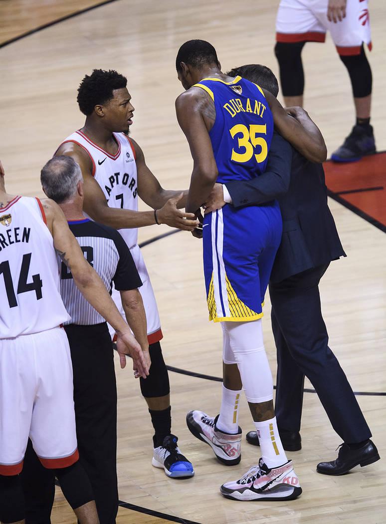 Golden State Warriors forward Kevin Durant (35) leaves after being injured as Toronto Raptors g ...