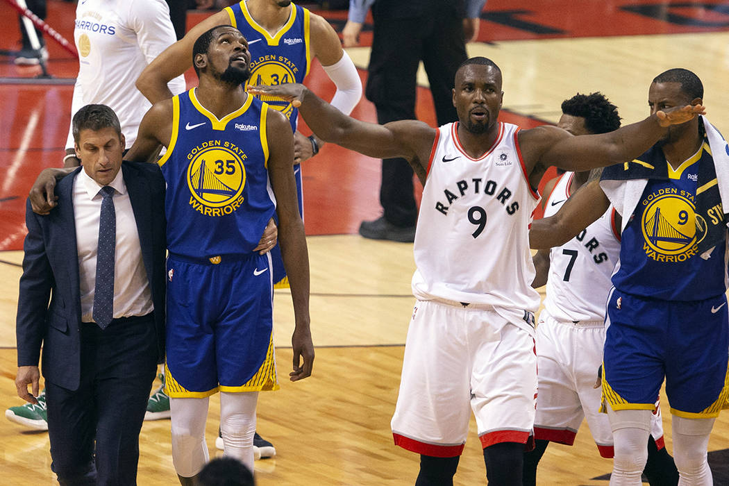 Golden State Warriors forward Kevin Durant (35) walks off the court after sustaining an injury ...