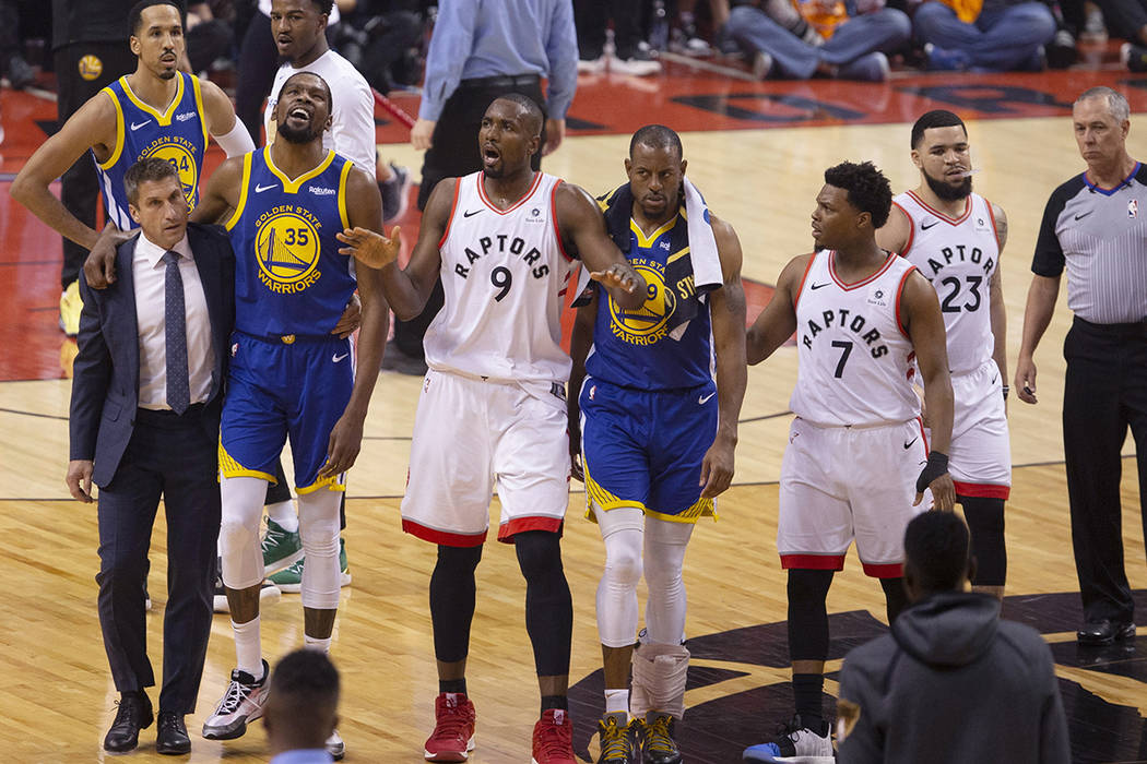Golden State Warriors' Kevin Durant (35) walks off the court after sustaining an injury as Toro ...