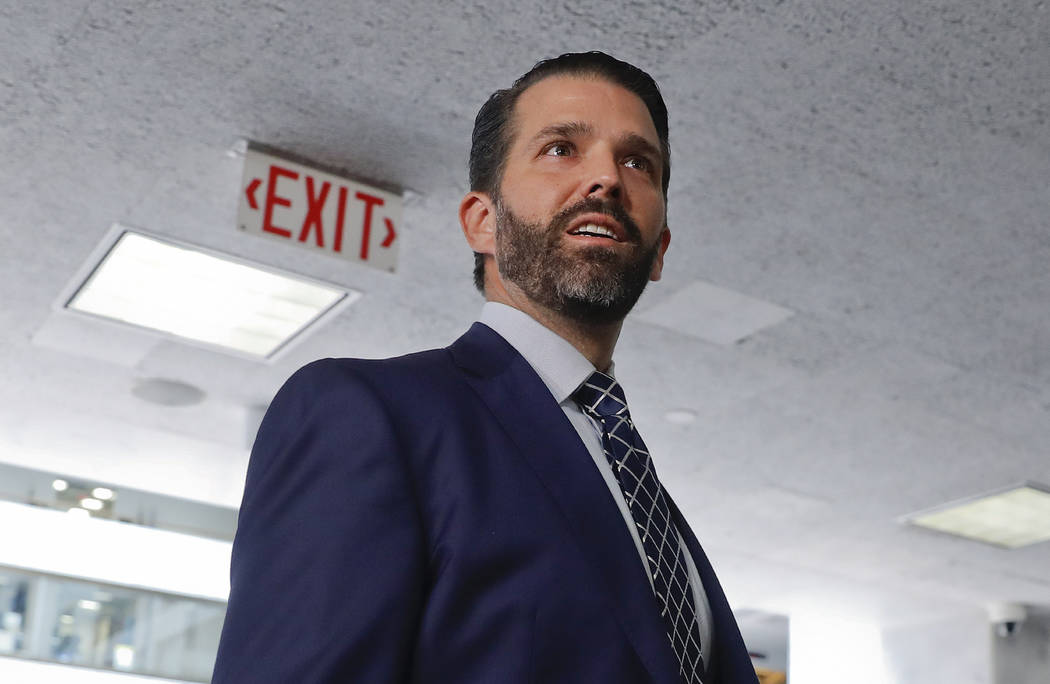 Donald Trump Jr., the son of President Donald Trump, is seen leaving after having met privately ...