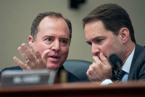 House Permanent Select Committee on Intelligence Chairman Adam Schiff of California, left, talk ...