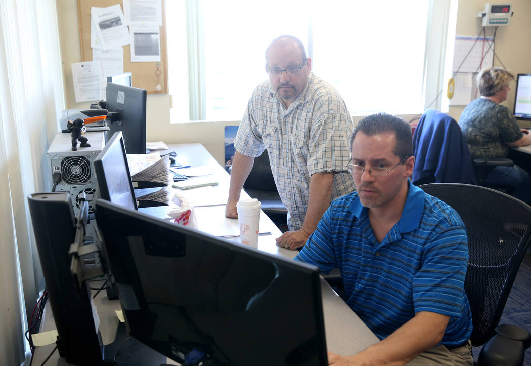 Truline Corporation employees Jason Rodriguez, driver manager, left, and Jason, Denz, fleet man ...