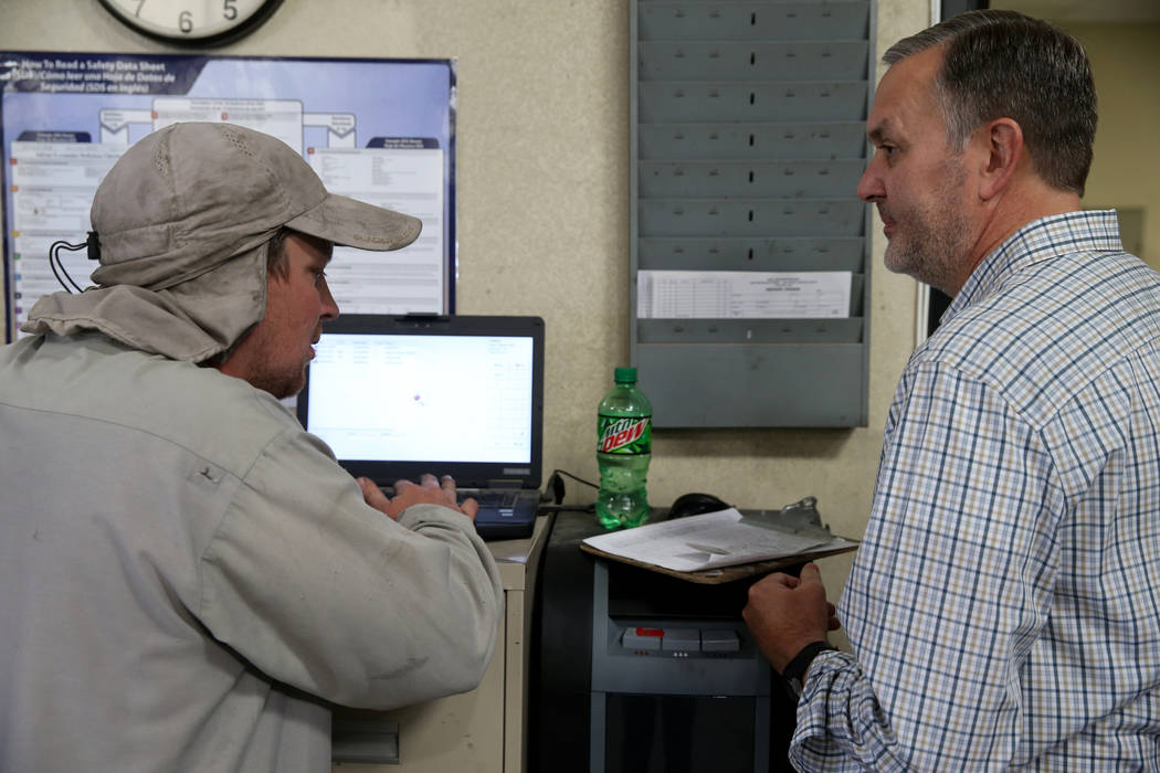 Paul Truman, owner of Truline Corporation, right, talks to lead trailer mechanic Chris Bianchi ...