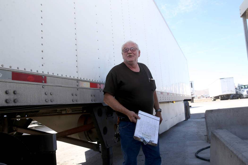 Tony Serpe, a driver trainer with Truline Corporation, prepares his rig at his trucking company ...