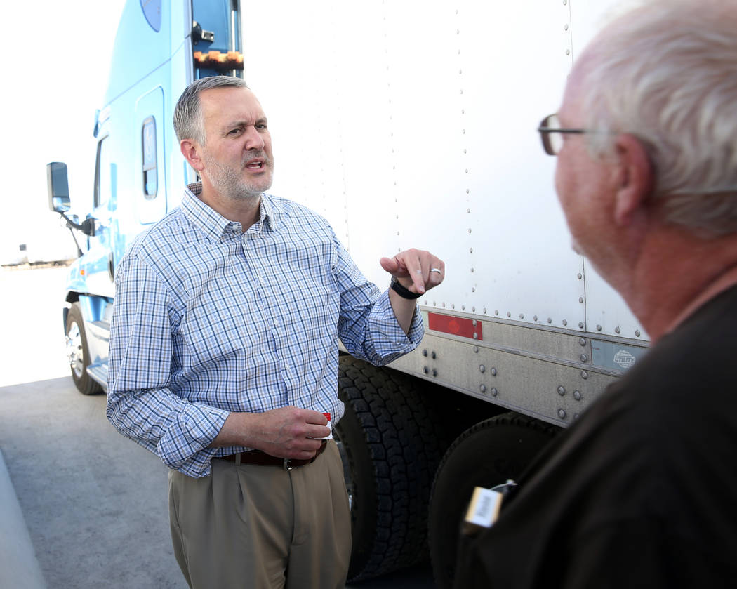 Paul Truman, owner of Truline Corporation, left, talks to driver trainer Tony Serpe at his truc ...