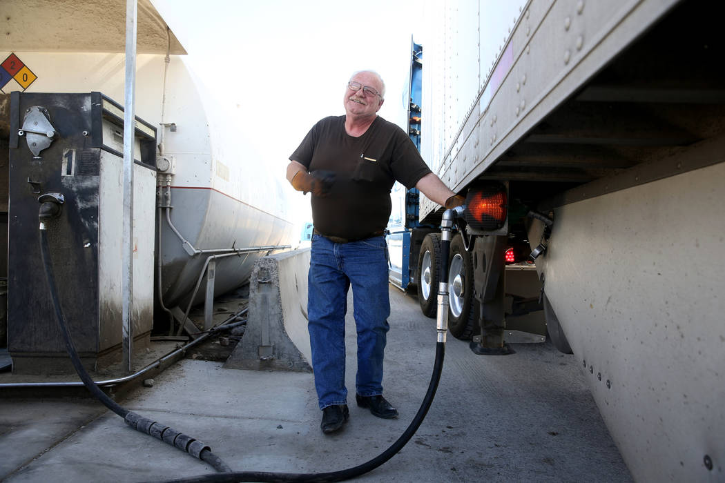 Tony Serpe, a driver trainer with Truline Corporation, fuels up his rig at his trucking company ...