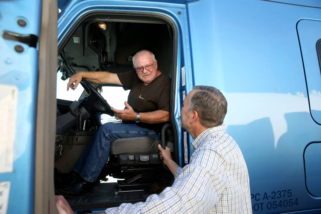 Paul Truman, owner of Truline Corporation, right, talks to driver trainer Tony Serpe at his tru ...