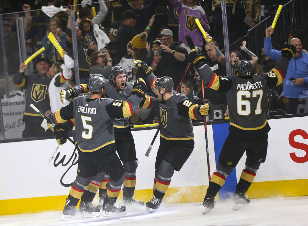 Golden Knights right wing Mark Stone, second from left, celebrates his goal with teammates Dery ...