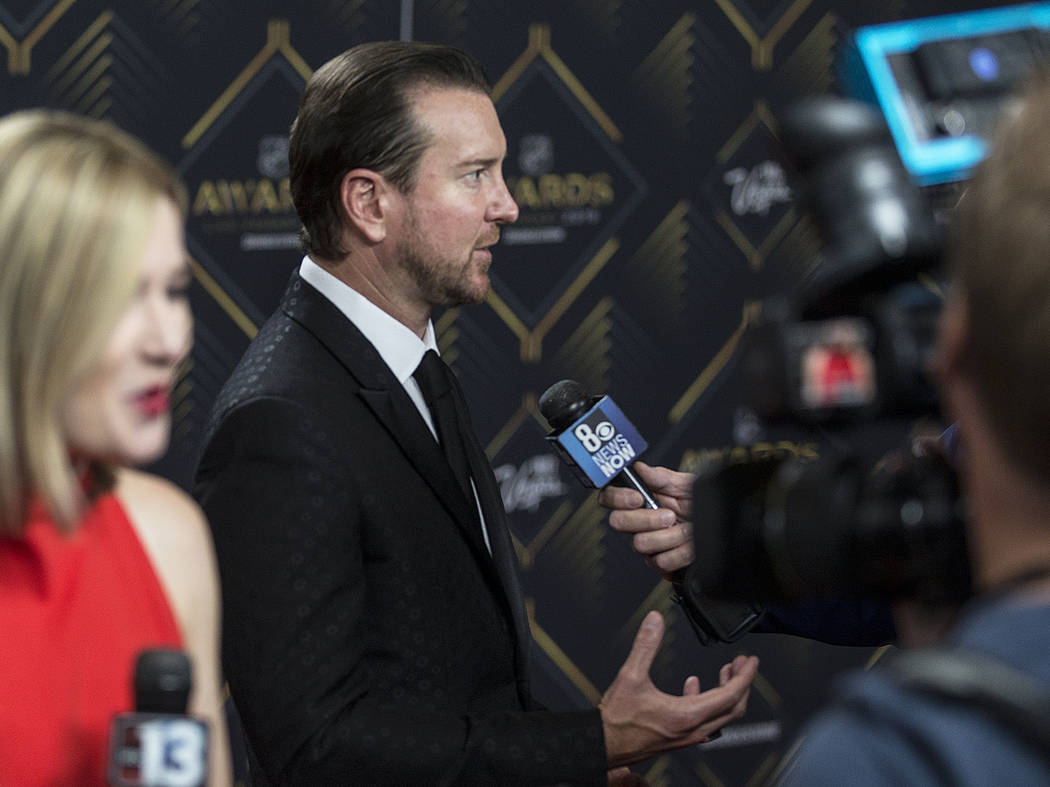 NASCAR driver Kurt Busch, center, talks with media on the red carpet before the start of the NH ...