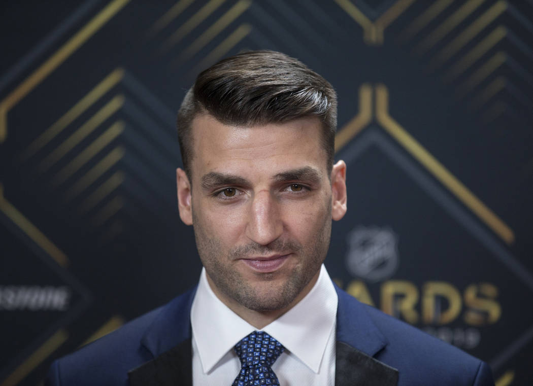 Boston Bruins center Patrice Bergeron walks the red carpet before the start of the NHL Awards o ...