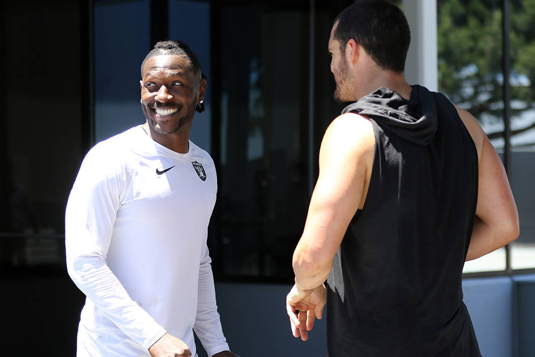 Oakland Raiders wide receiver Antonio Brown meets with quarterback Derek Carr after an offseaso ...