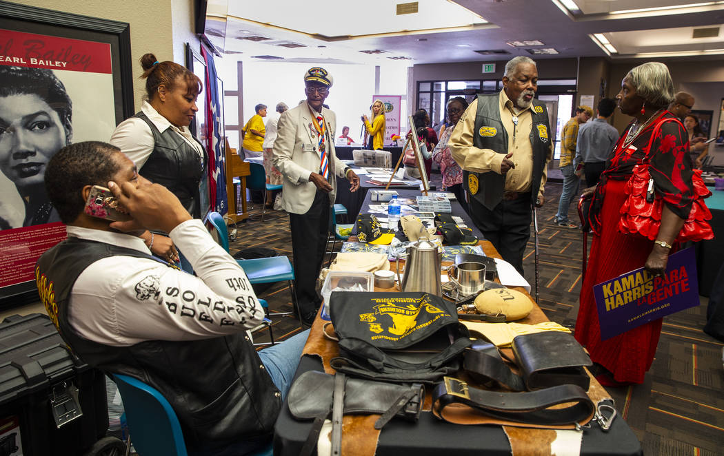 The Southern Nevada chapter of the Las Vegas Buffalo Soldiers members chat with attendees durin ...