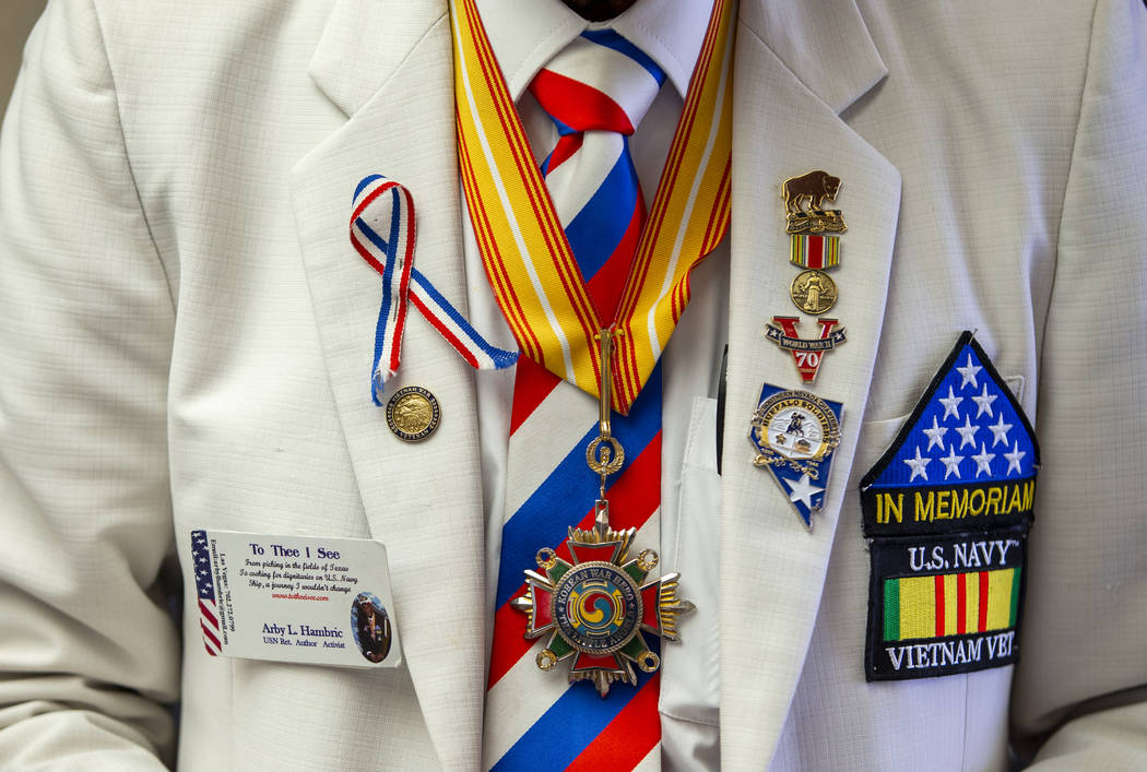 Decorated jacket of World War II, Korea, and Vietnam veteran Arby Hambric why is both author an ...