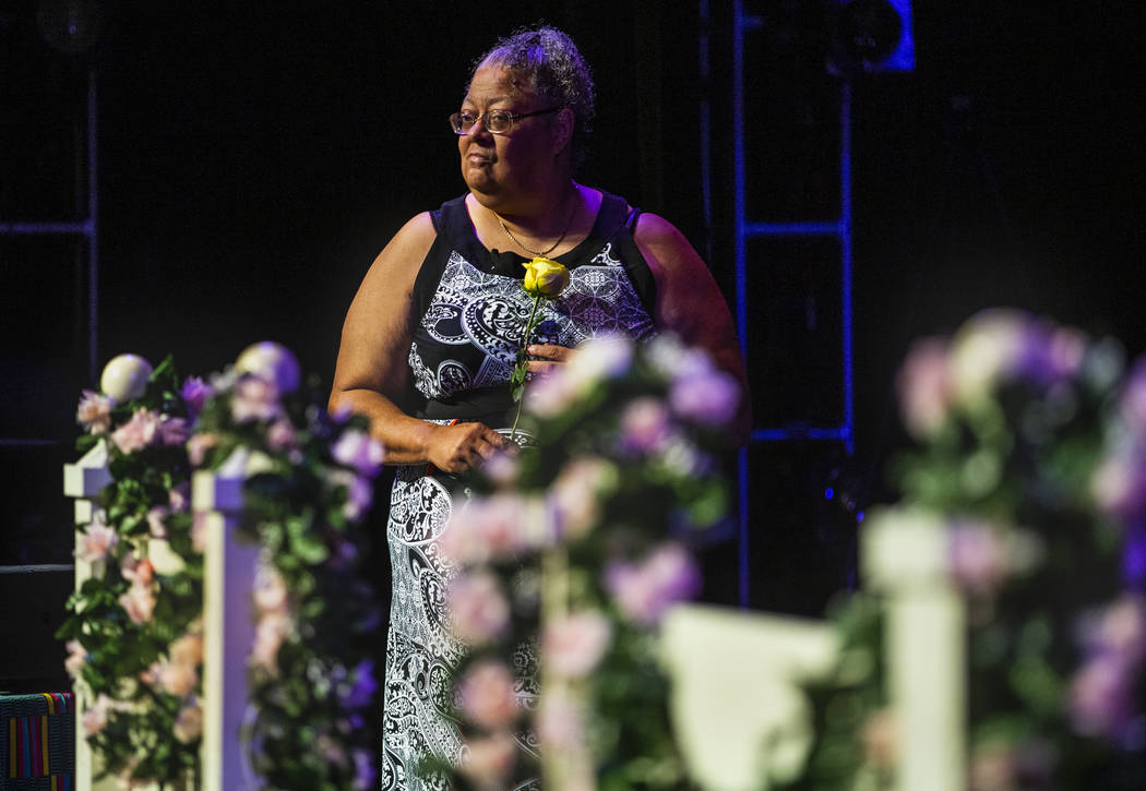 Organizer Dee Harris holds a rose during a Bridge of Peace Reconciliation Ceremony by the Women ...