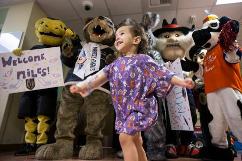 Camila Silva, 2, dances with a group of Las Vegas-based mascots during a welcome event for Mile ...
