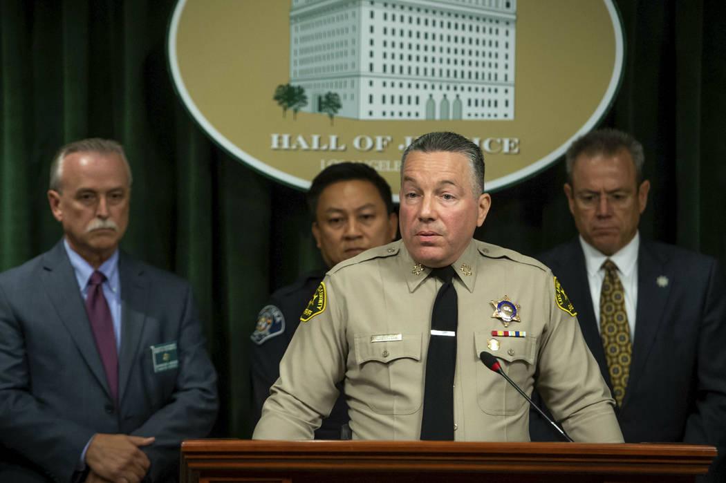 Los Angeles County Sheriff Alex Villanueva, with Sheriff's Homicide Capt. Kent Wegener, from le ...