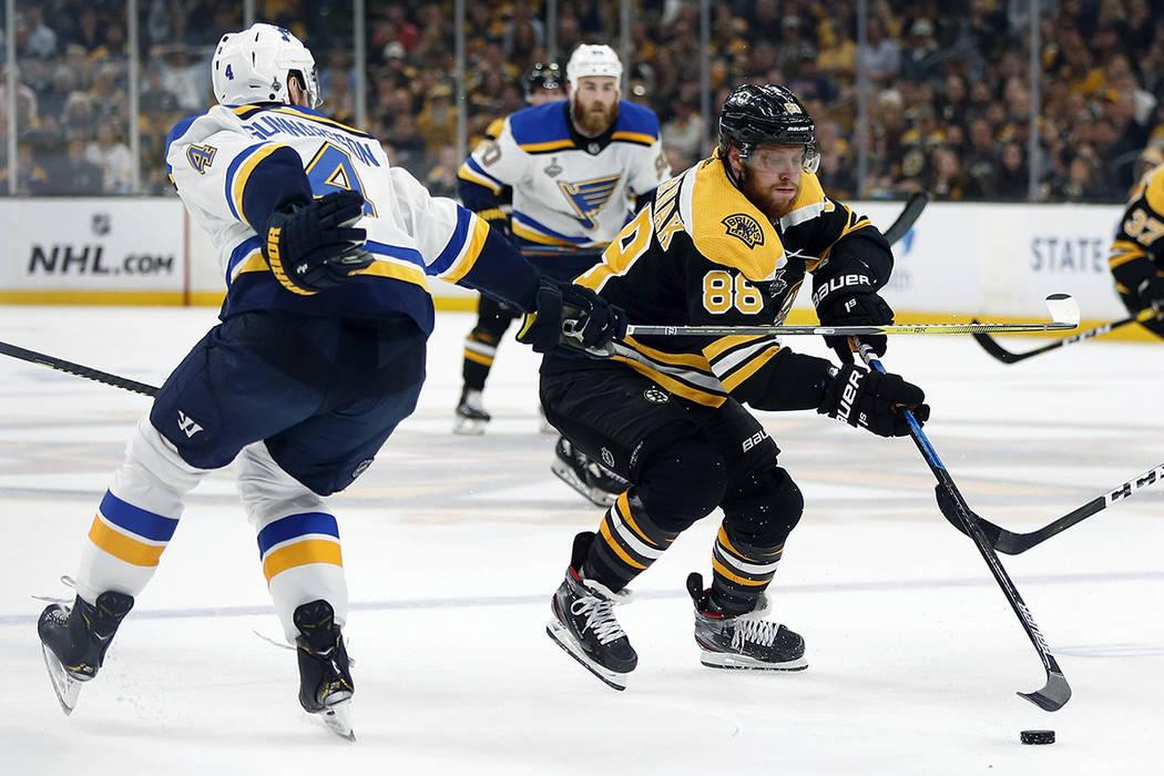 St. Louis Blues' Carl Gunnarsson, left, of Sweden, defends against Boston Bruins' David Pastrna ...