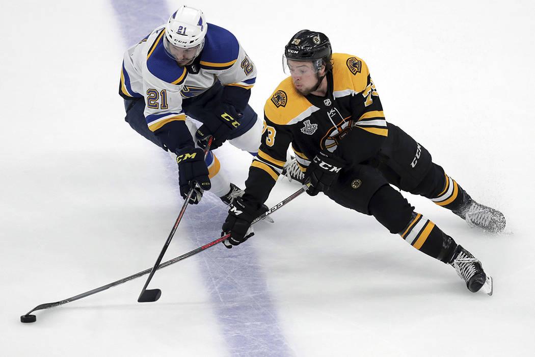 St. Louis Blues' Tyler Bozak, left, defends against Boston Bruins' Charlie McAvoy during the se ...