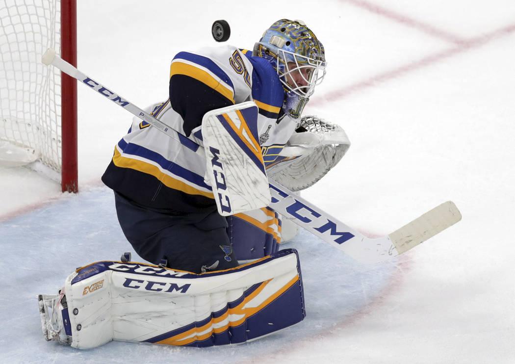 St. Louis Blues goaltender Jordan Binnington turns a shot away during the second period in Game ...
