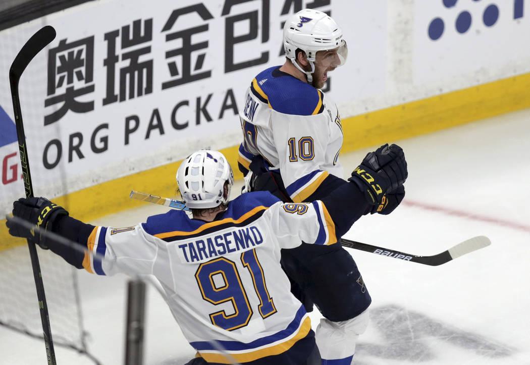 St. Louis Blues' Brayden Schenn (10) celebrates his goal against the Boston Bruins with Vladimi ...