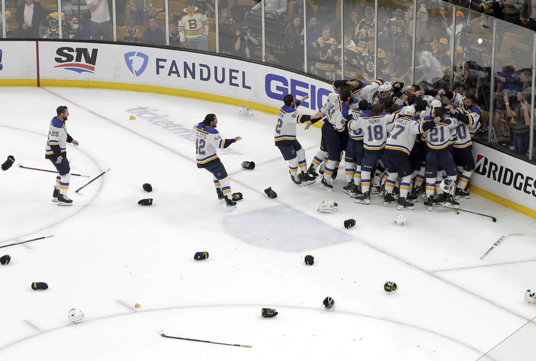 The St. Louis Blues celebrate their win over the Boston Bruins in Game 7 of the NHL hockey Stan ...