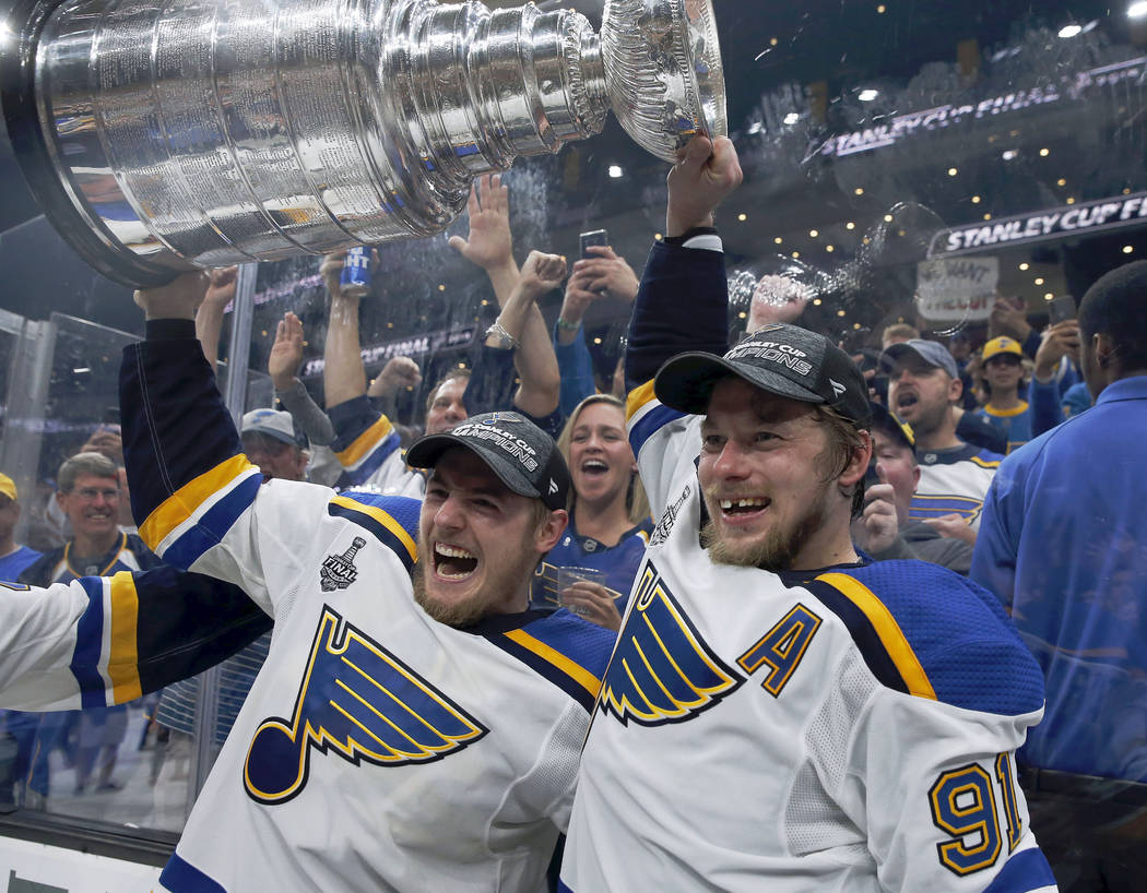 St. Louis Blues' Ivan Barbashev, left, and Vladimir Tarasenko, both of Russia, hold the Stanley ...