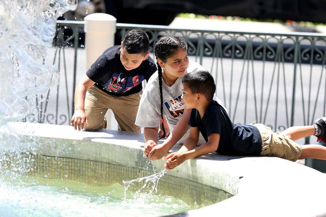 Children cool themselves at The Venetian water fountain on theLasVegas Strip. Tempe ...