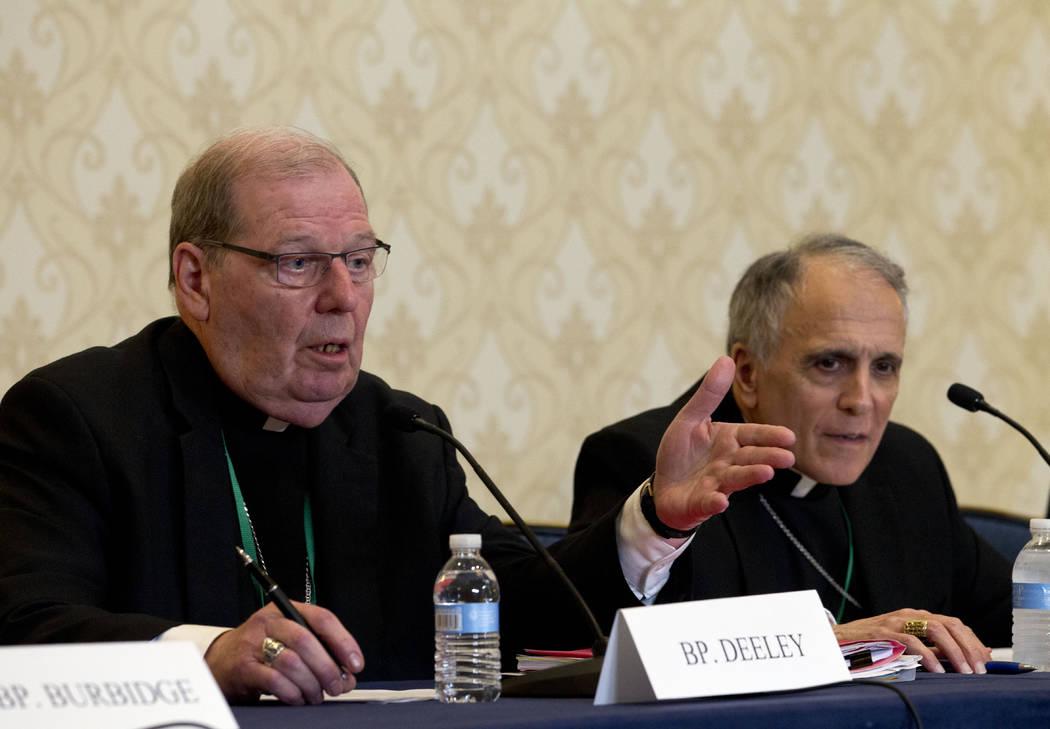 Robert Deeley, left, Bishop of the Diocese of Portland, accompanied by Cardinal Daniel DiNardo, ...