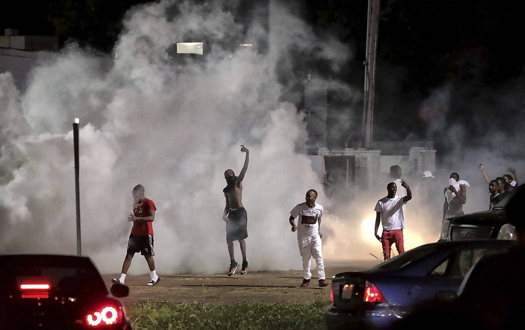 Frayser community residents taunt authorities as protesters take to the streets in anger agains ...