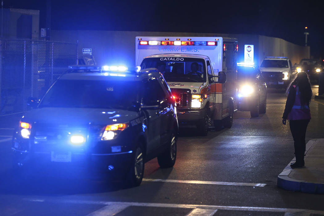 An ambulance carrying David Ortiz is escorted to Mass General Hospital in Boston Monday night, ...