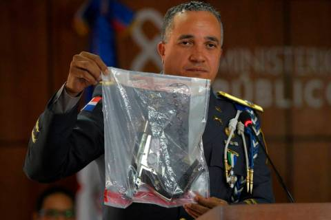 The director of the National Police, General Ney Aldrin Bautista Almonte shows the weapon that ...