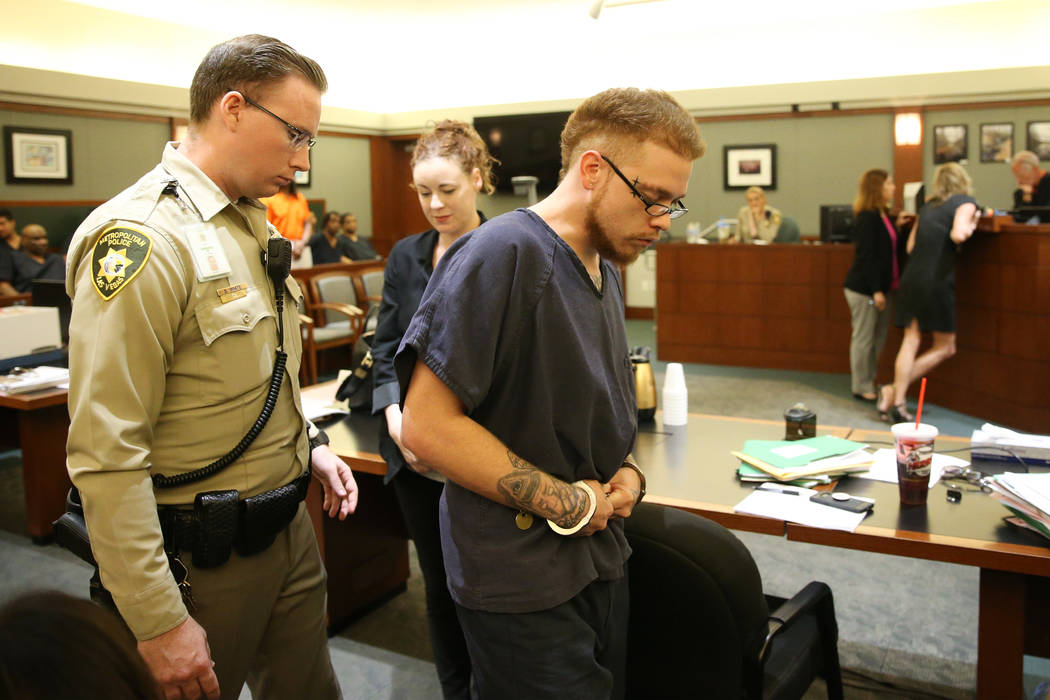 Jon Kennison is escorted out of the courtroom after pleading not guilty to a murder charge in t ...