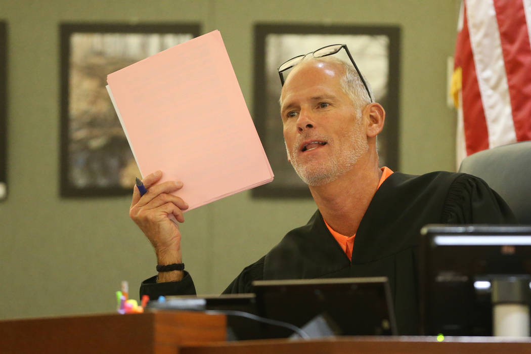 District Judge Douglas Herndon speaks during a court hearing for Jon Kennison and Kelsey Turne ...