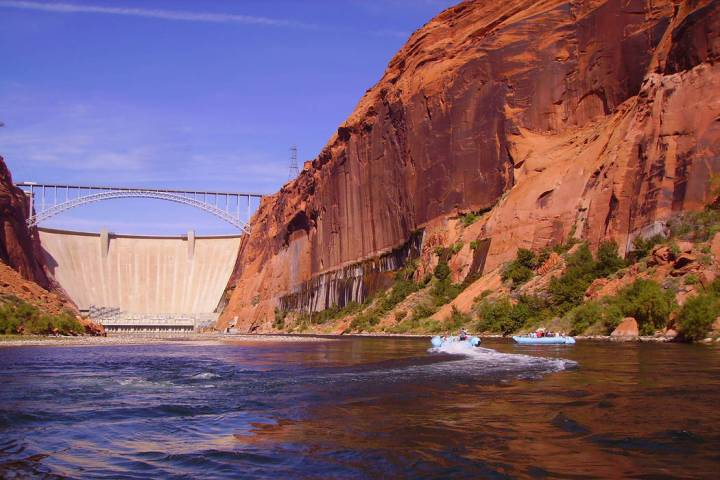 Glen Canyon offers a feast for the eyes with the red and orange cliffs and clear blue water. (D ...